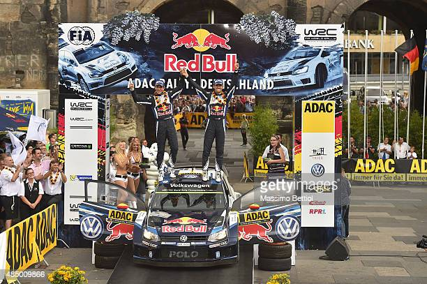 Sebastien Ogier of France and Julien Ingrassia of France celebrate their first position in the final overall during Day Three of the WRC Germany on...