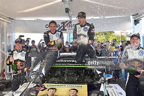 Sebastien Ogier of France and Julien Ingrassia of France celebrate their victory in the rally and their third World Rally Championship Title during...