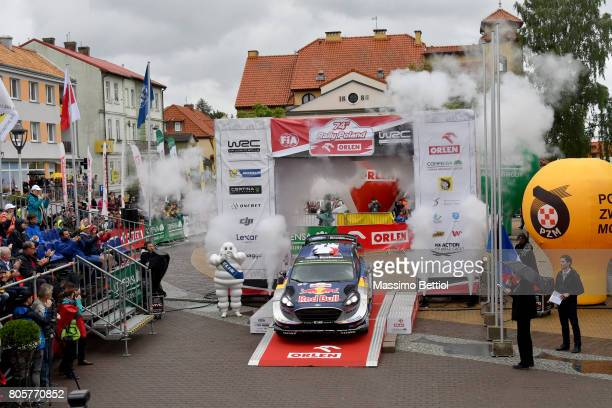 Sebastien Ogier of France and Julien Ingrassia of France celebrate their third position in the final overall during Day Three of the WRC Poland on...