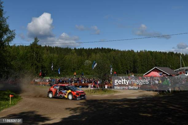 Sebastien Ogier of France and Julien Ingrassia of France compete in their Citroen Total WRT Citroen C3 WRC during Day Two of the FIA WRC Neste...