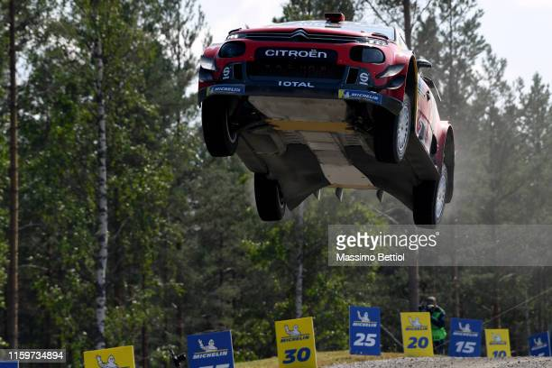 Sebastien Ogier of France and Julien Ingrassia of France compete in their Citroen Total WRT Ctroen C3 WRC during Day Three of the FIA WRC Neste...