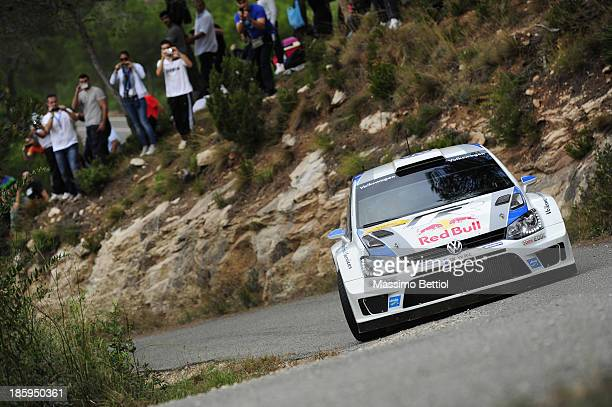 Sebastien Ogier of France and Julien Ingrassia of France compete in their Volkswagen Motorsport Polo R WRC during Day Two of the WRC Spain on October...