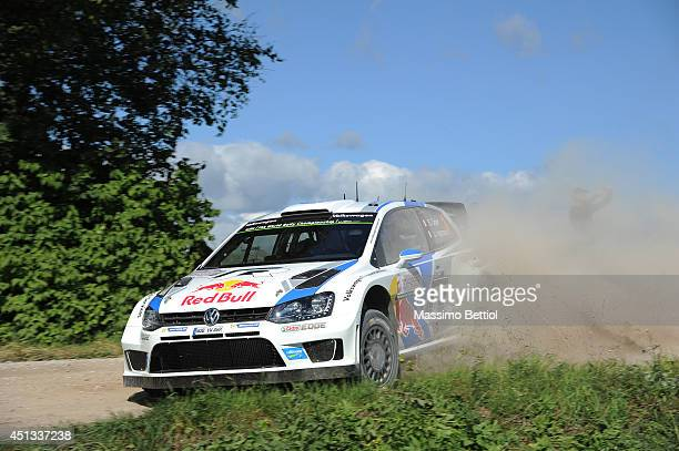 Sebastien Ogier of France and Julien Ingrassia of France compete in their Volkswagen Motorsport Polo R WRC during Day One of the WRC Poland on June...