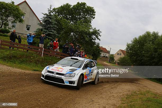 Sebastien Ogier of France and Julien Ingrassia of France compete in their Volkswagen Motorsport Polo R WRC during Day Three of the WRC Poland on June...
