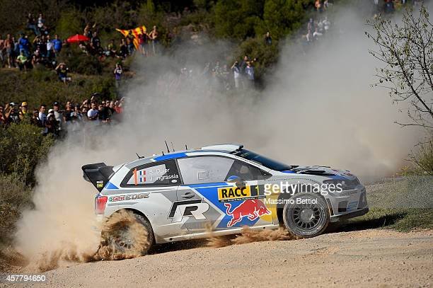 Sebastien Ogier of France and Julien Ingrassia of France compete in their Volkswagen Motorsport Volkswagen Polo R WRC during Day One of the WRC Spain...