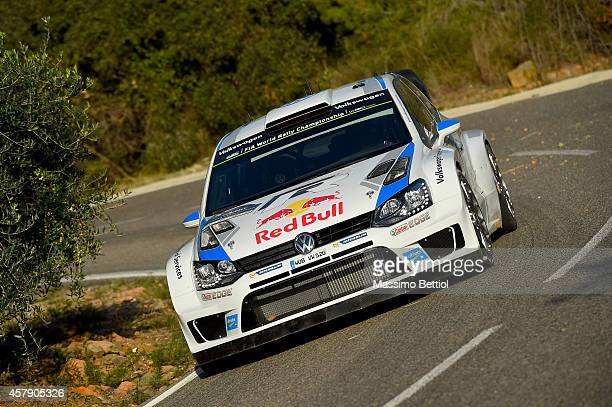 Sebastien Ogier of France and Julien Ingrassia of France compete in their Volkswagen Motorsport Volkswagen Polo R WRC during Day Three of the WRC...
