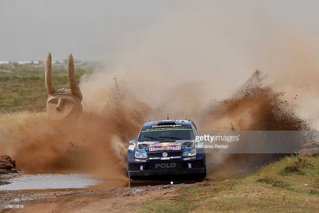 Sebastien Ogier of France and Julien Ingrassia of France compete in their Volkswagen Motorsport Volkswagen Polo R WRC during Day One of the WRC Rally Italia Sardinia on June 12, 2015 in Alghero, Italy.