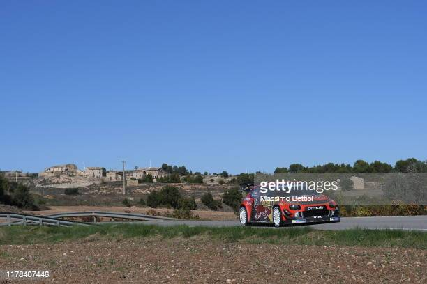Sebastien Ogier of France and Julien Ingrassia of France compete with their Citroen Total WRT Citroen C3 WRC during Day Two of the FIA WRC RACC...