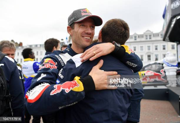 Sebastien Ogier of France and MSport Ford World Rally Team celebrates with his team following victory on day four of the FIA World Rally Championship...