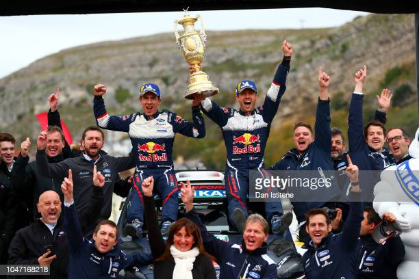 Sebastien Ogier of France and MSport Ford World Rally Team celebrates victory with codriver Julien Ingrassia of France and their team after winning...