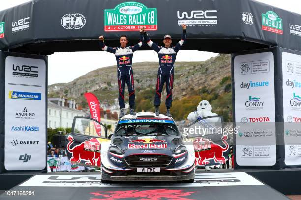 Sebastien Ogier of France and MSport Ford World Rally Team celebrates vicotry with codriver Julien Ingrassia of France after winning the Great Orme...