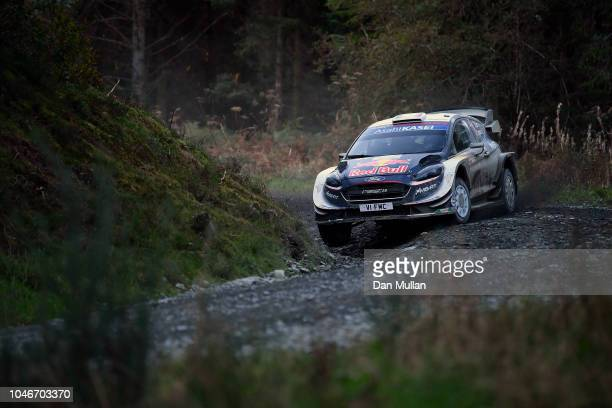 Sebastien Ogier of France and MSport Ford World Rally Team drives with codriver Julien Ingrassia of France during the Dyfi stage on day three of the...
