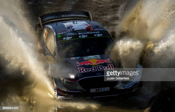 Sebastien Ogier of France and MSport World Rally Team drives with codriver Julien Ingrassia of France during the Sweet Lamb stage of the FIA World...