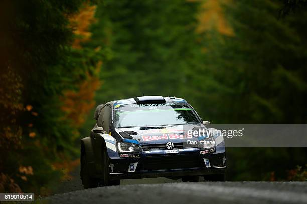 Sebastien Ogier of France and Volkswagen Motorsport drives with codriver Julien Ingrassia of France and Volkswagen Motorsport during the Dyfi stage...