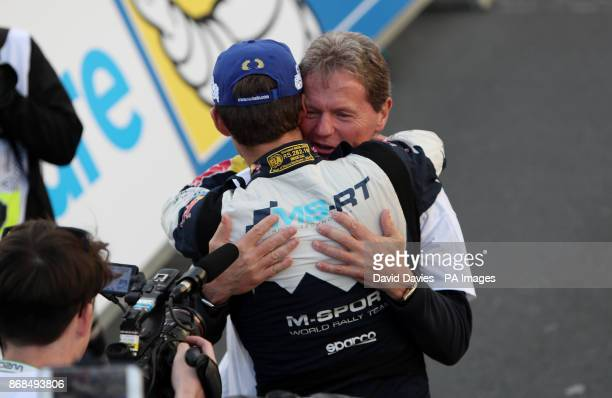 Sebastien Ogier of France celebrates winning the World Championship in the MSport WRT Ford Fiesta WRC with Malcolm Wilson during day four of the...