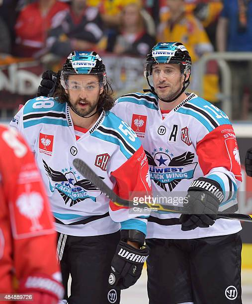 Sebastien Piche and Brett McLean of the Black Wings Linz celebrate after scoring the 01 during the game between Duesseldorfer EG and Black Wings Linz...