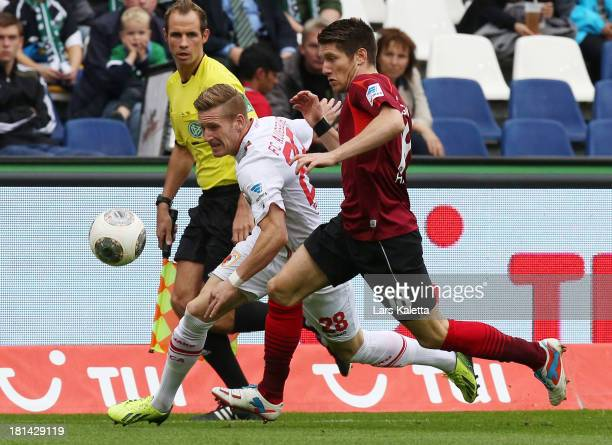 Sebastien Pocognoli of Hannover challenges with Andre Hahn of Augsburg during the bundesliga match between Hannover 96 and FC Augsburg at HDI Arena...