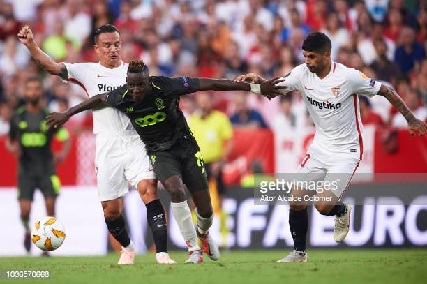 Sebastien Pocognoli of Royal Standard de Liege competes for the ball with Roque Mesa of Sevilla FC and Ever Banega of Sevilla FC during the UEFA...