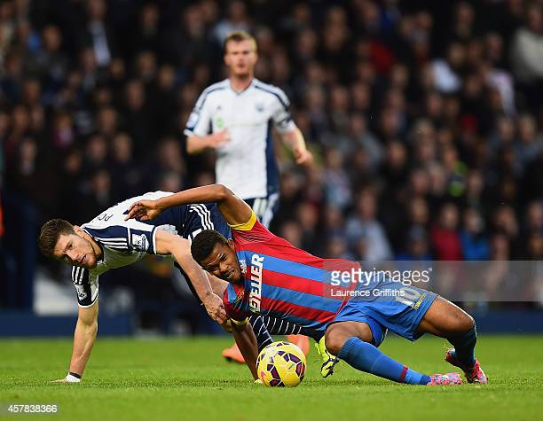 Sebastien Pocognoli of West Brom and Fraizer Campbell of Crystal Palace battle for the ball during the Barclays Premier League match between West...