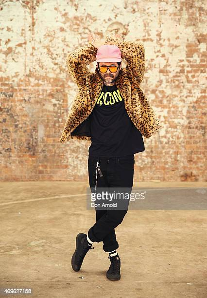 Sebastien Rougere wears Mink Pink jacket, Discount Universal T-shirt, Levis Jeans, Happy socks and Converse shoes at Mercedes-Benz Fashion Week...