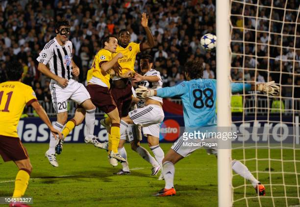 Sebastien Squillaci of Arsenal scores past goalkeeper Vladimir Stojkovic of Belgrade to make it 31 during the UEFA Champions League Group H match...