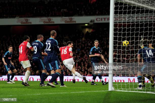 Sebastien Squillaci of Arsenal scores the opening goal during the Barclays Premier League match between Arsenal and Stoke City at the Emirates...