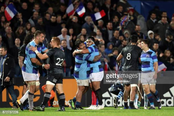 Sebastien Taofifenua and Emerick Setiano of Barbarians celebrate victory during the test match between Barbarians and Maori All Blacks at Stade...