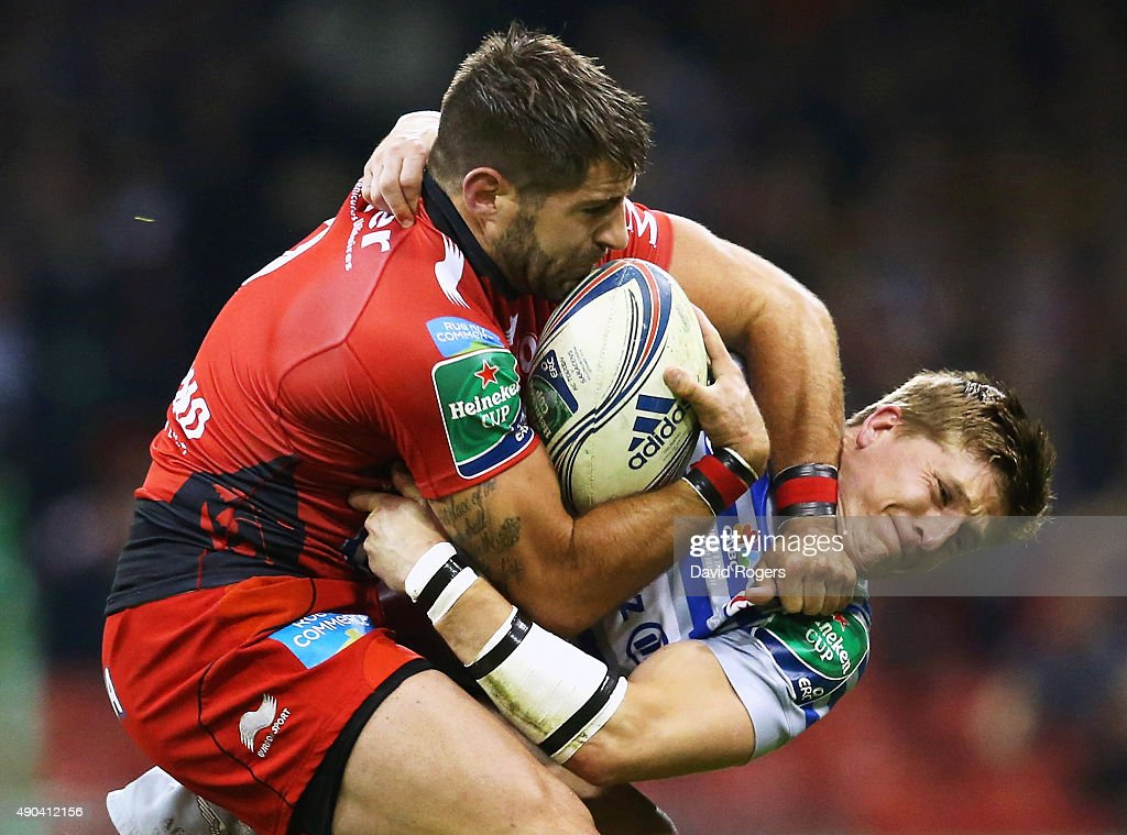 Sebastien Tillous-Borde of Toulon holds off the challenge from David Strettle of Saracens during the Heineken Cup Final between Toulon and Saracens at the Millennium Stadium on May 24, 2014 in Cardiff, United Kingdom.