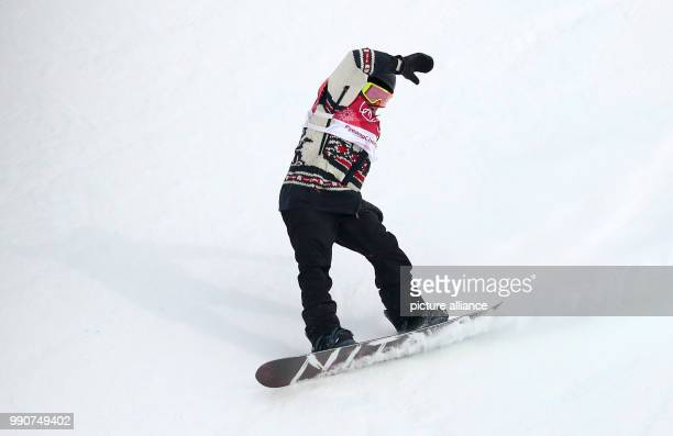 Sebastien Toutant from Canada performs a pirouette during the Snowboard Big Air finals in Pyeongchang South Korea 24 February 2018 Photo Daniel...