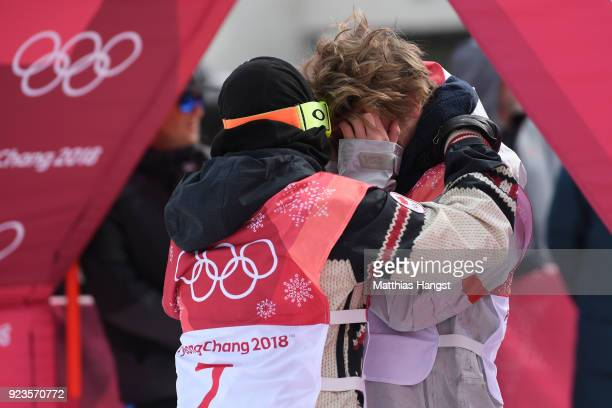 Sebastien Toutant of Canada and Kyle Mack of the United States celebrate winning medals during the Men's Big Air Final on day 15 of the PyeongChang...