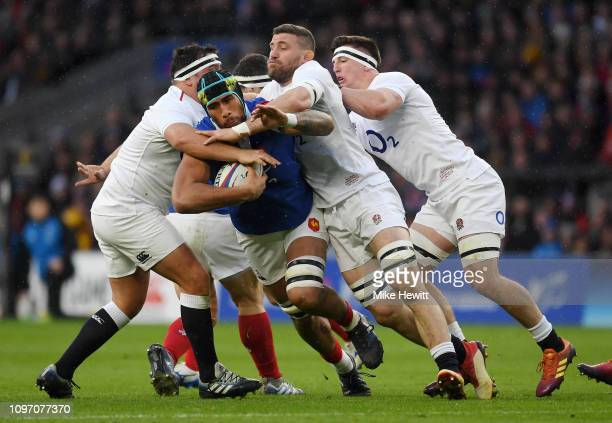Sebastien Vahaamahina of France is stopped by Jamie George and Mark Wilson of England during the Guinness Six Nations match between England and...