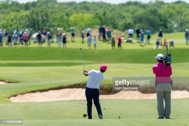 Sebastián Muñoz hits his approach to during the final round of the ATT Byron Nelson on May 12 2019 at Trinity Forest Golf Club in Dallas TX
