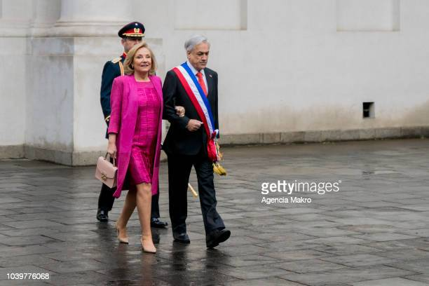 Sebastián Piñera President of Chile walks with the First Lady Cecilia Morel as they enter to the Palacio de La Moneda to take part in the traditional...