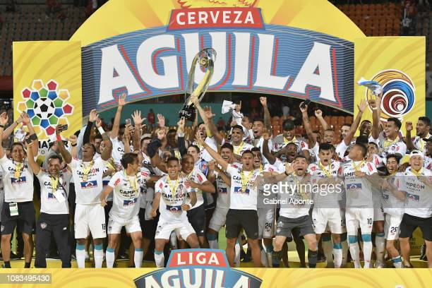 Sebastián Viera of Junior lifts the trophy to celebrate with his teammates after the second leg final match of the Torneo Clausura Liga Aguila 2018...