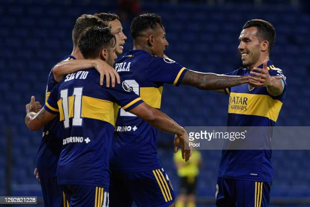 Sebastián Villa of Boca Juniors celebrates with teammate Carlos Tevez after scoring the the second goal of his team during a quarter final second leg...