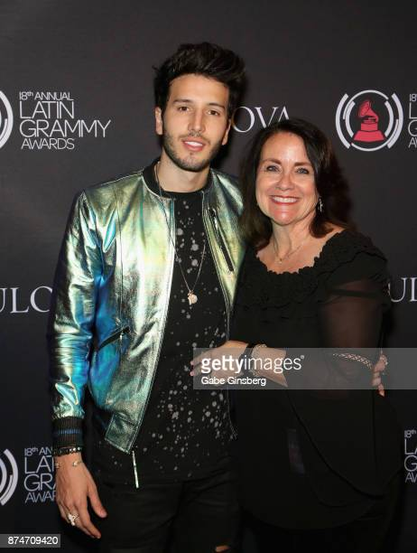 Sebastián Yatra and Bulova Regional Manager of Merchanising Sheri Francis attends the gift lounge during the 18th annual Latin Grammy Awards at MGM...