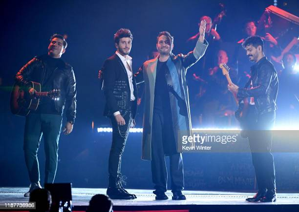 Sebastián Yatra and Reik perform onstage during the 20th annual Latin GRAMMY Awards at MGM Grand Garden Arena on November 14 2019 in Las Vegas Nevada