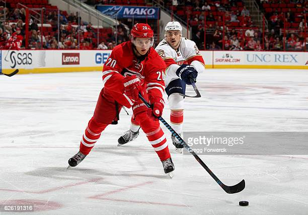 Sebastina Aho of the Carolina Hurricanes passes the puck during an NHL game against the Florida Panthers on November 27 2016 at PNC Arena in Raleigh...