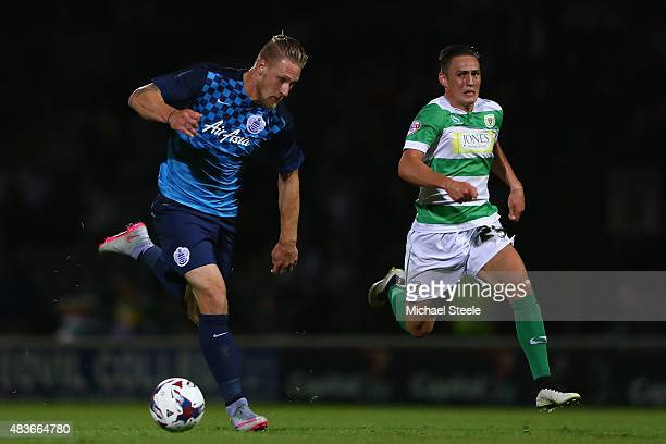 Sebastion Polter of Queens Park Rangers is tracked by Connor Roberts of Yeovil Towduring the Capital One Cup First Round match between Yeovil Town...