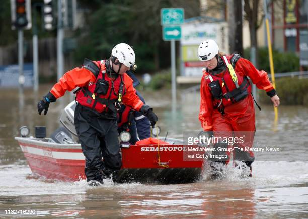 Sebastopol firefighters return from a search and rescue mission in the flood waters from the Laguna de Santa Rosa near The Barlow market in...