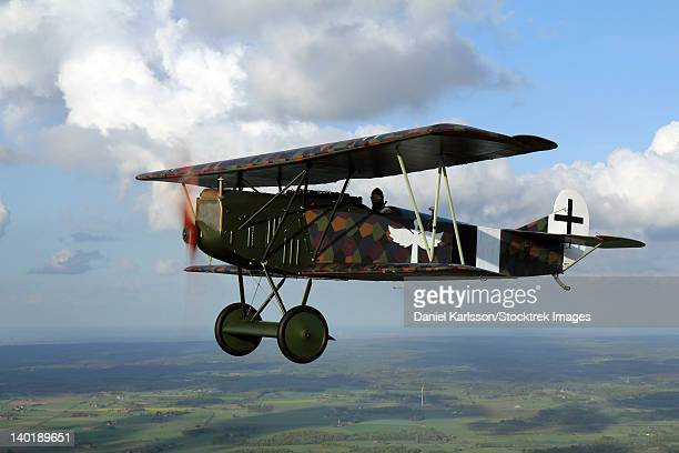 sebbarp, sweden - fokker d.vii world war i replica fighter in the air. - wwi plane stock pictures, royalty-free photos & images