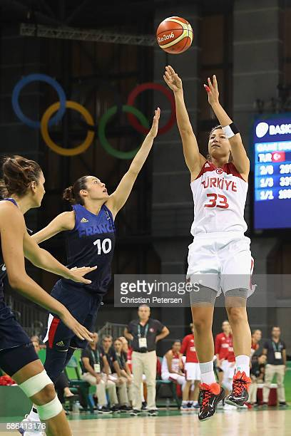 Sebnem Nezahat Kimyacioglu of Turkey attempts a three point shot over Sarah Michel of France during a Women's Basketball Preliminary Round game on...