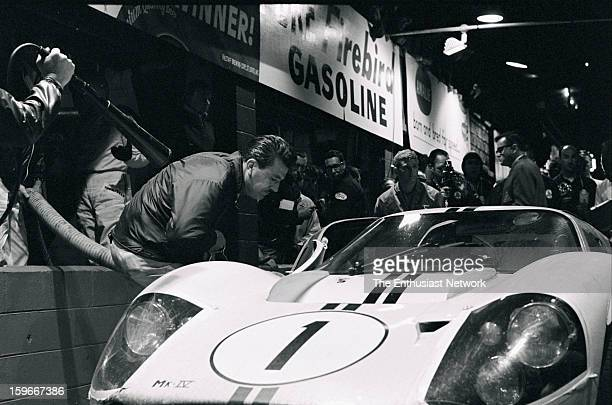 Sebring 12 Hour Race. Bruce McLaren and Mario Andretti's Ford GT-40 sits in the pits. The driver tandem proved successful by starting the race from...