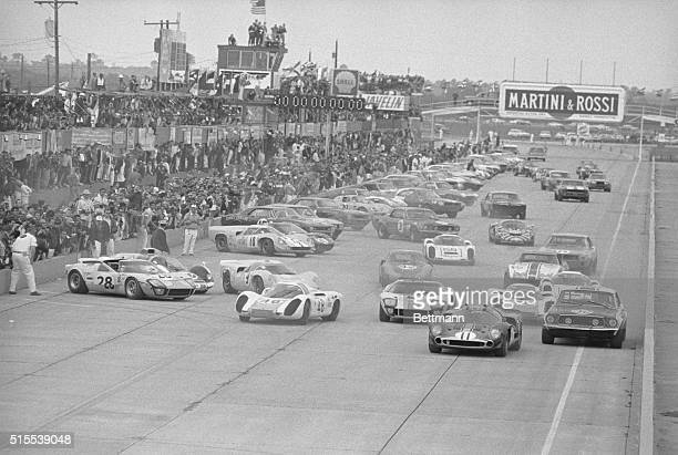A field of 70 cars jams the straightaway at the starting line as they're off and running in the annual 12 hour Grand Prix of Endurance