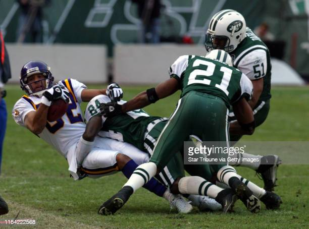 10/20/02 Secaucus NJ Minnesota Vikings vs New York Jets ta the Meadowlands Viking wide receiver Derrick Alexander is brought down after a reception...
