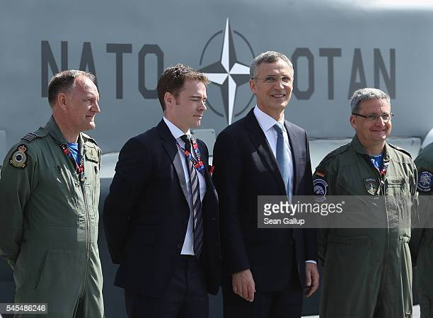 Secetary General Jens Stoltenberg poses with flight crew members of a NATO Global Hawk reconaissance drone outside the PGE National Stadium site of...