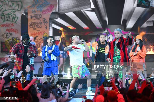 Sech Lenny Taveres Feid Dalex perform and Cazzu on stage during Premios Juventud 2019 at Watsco Center on July 18 2019 in Coral Gables Florida