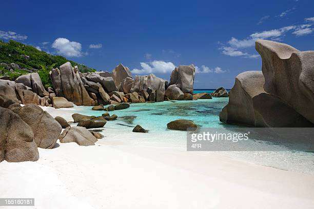 secluded bay, anse marron, seychelles - la digue island stock pictures, royalty-free photos & images