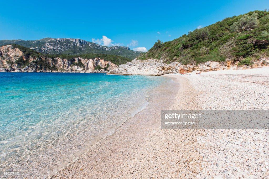 Secluded Rovinia beach in Liapades village, Corfu, Greece : Stock Photo