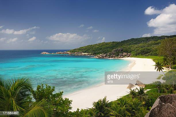 secluded tropical bay - la digue island stock pictures, royalty-free photos & images